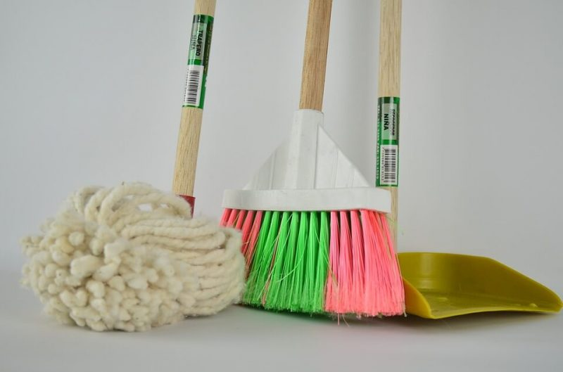 a mop a dust pan and a mop