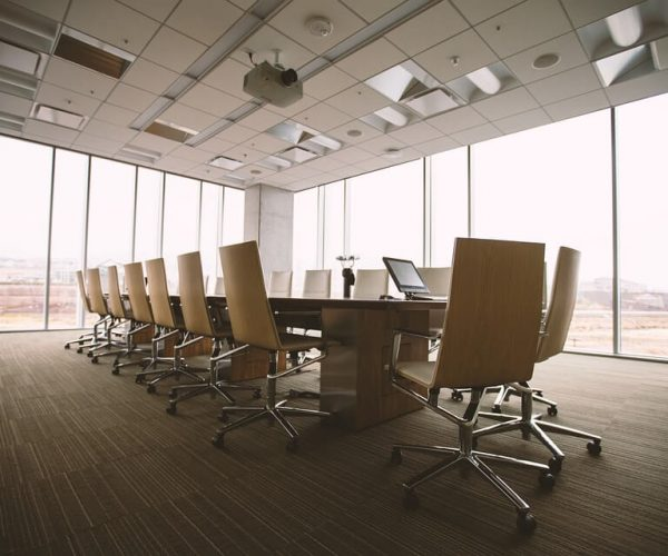 chairs around large table in office