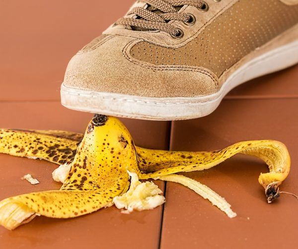 shoe about to stand on banana